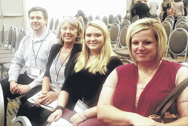 Prosecutor James K. Stanley is pictured with advocates Theda Petrasko, Alexis Schwab and Shelley Kemper at the Two Days in May conference.