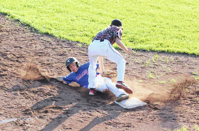Tyler Tillis slides safely into third base, during the Rangers' 12-4 victory on Thursday in Rocksprings, Ohio.