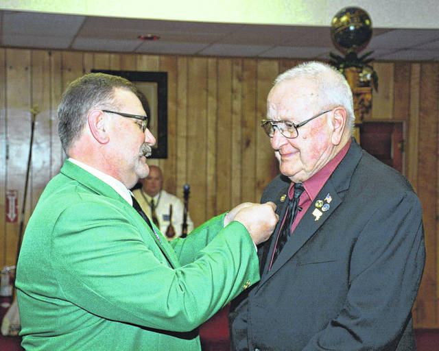 Larry Byer, left, presents his father Bob Byer with his 50-year Lodge pin.