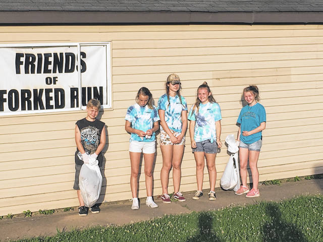 Local 4-H Club members were among those helping with the annual Ohio River Sweep on Friday evening at Forked Run State Park.