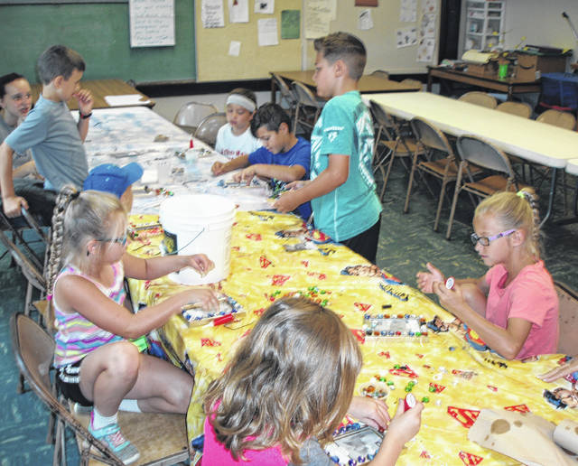 Syracuse Community Center summer program participants work on Father's Day crafts.