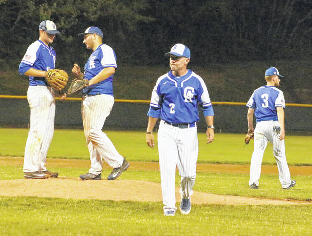 Gallia Academy baseball coach Rich Corvin (2) gives a stare down to the home plate umpire after leaving a meeting on the mound during a May 14 Division II district semifinal contest at Rannow Field in The Plains, Ohio.