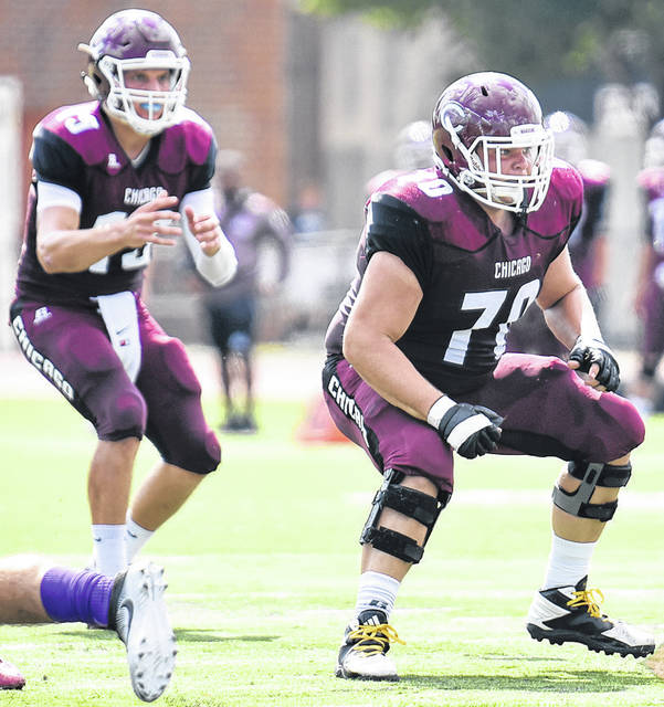 Owen Moore (70) prepares to pass block during the Maroon's 35-16 victory over Millsaps on Sept. 17, 2016, in Chicago, Ill.