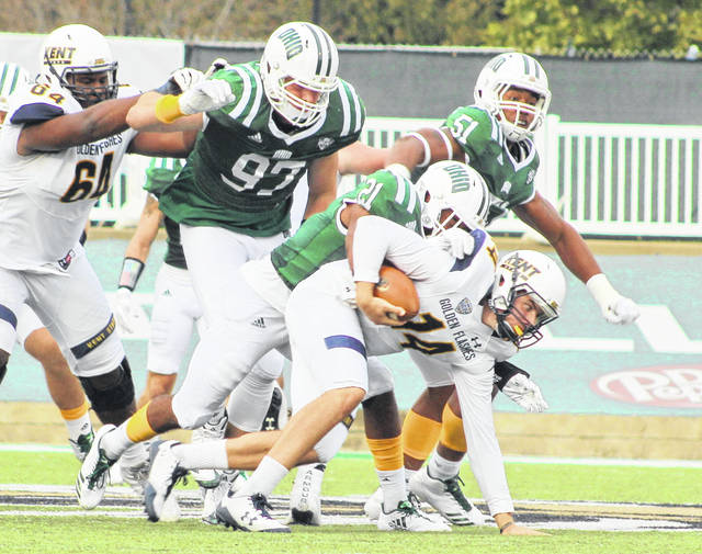 Ohio cornerback Jalen Fox (21) sacks Kent State quarterback Dustin Crum as teammates Kent Berger (97) and Will Evans (51) follow on the play during the third quarter of a Mid-American Conference football game at Peden Stadium on Oct. 21, 2017, in Athens, Ohio.