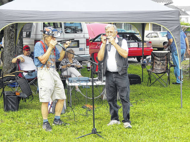 Harmonica players perform in the Chester Commons