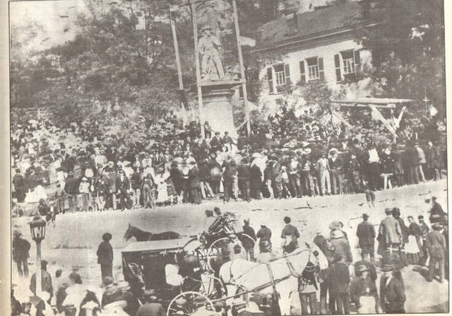"This photo, which appeared in the 175th anniversary of Meigs County edition of The Daily Sentinel in 1994, shows the crowd gathered at the Meigs County Courthouse in Pomeroy for the 1871 dedication of the Civil War Soldier Monument located next to the courthouse. The monument still stands on the Mulberry Avenue side of the courthouse as a reminder of the sacrifice of Meigs County residents who fought and died in the Civil War. According to article accompanying the photo in the anniversary edition written by Jim Freeman, in March 1870, the Meigs County Board of Commissioners, upon the petition of county residents, dedicated all of the ground lying west of the courthouse between the courthouse and Mulberry to the ""sacred purpose of erecting a monument to the memory of the soldiers of said county who died in the service of their country during the great rebellion."" The monument was completed in October 1871, with the dedication and unveiling taking place on Oct. 17, 1871 with an estimated 2,500 people in attendance."