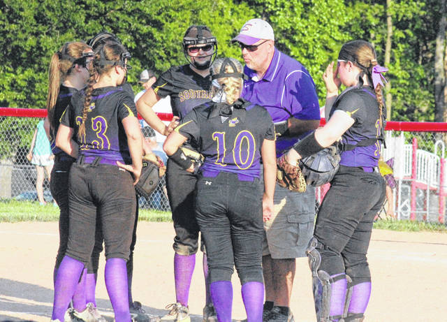 Alan Crisp talks to his infield during a Division IV district softball game on May 18, 2017, in Minford, Ohio.