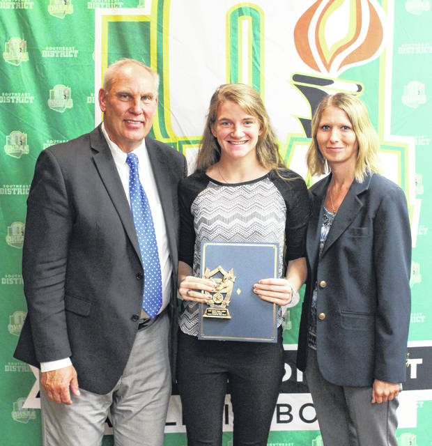 Jessica Cook recently received one of the OHSAA/SEDAB Scholarship. Cook is pictured with Jerry Snodgrass (OHSAA Executive Director) and Stephanie Evans (representing the SEDAB).