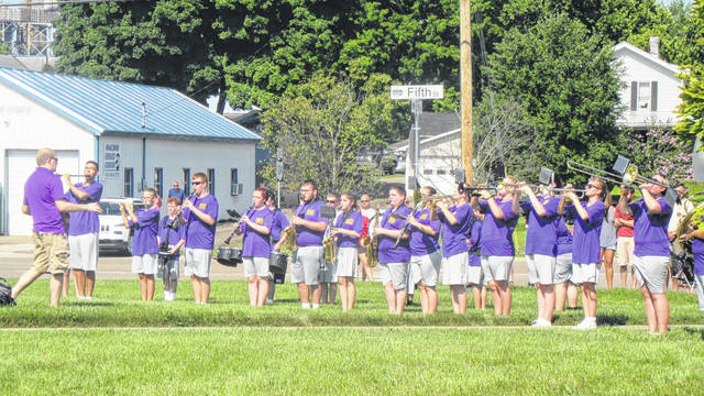 The Southern Marching Band performs the National Anthem for the flag raising at Home National Bank.