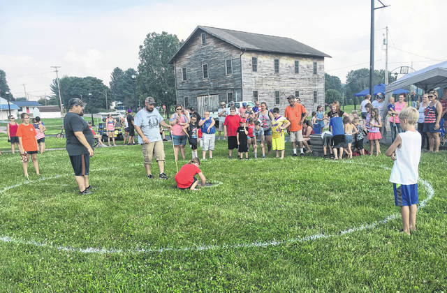 A crowd gathered at Star Mill Park on Wednesday afternoon for the frog jumping contest.