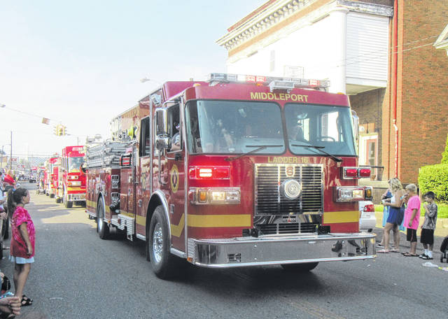 The Middleport Fire Department led a line of fire trucks through the parade in Middleport on Wednesday evening.