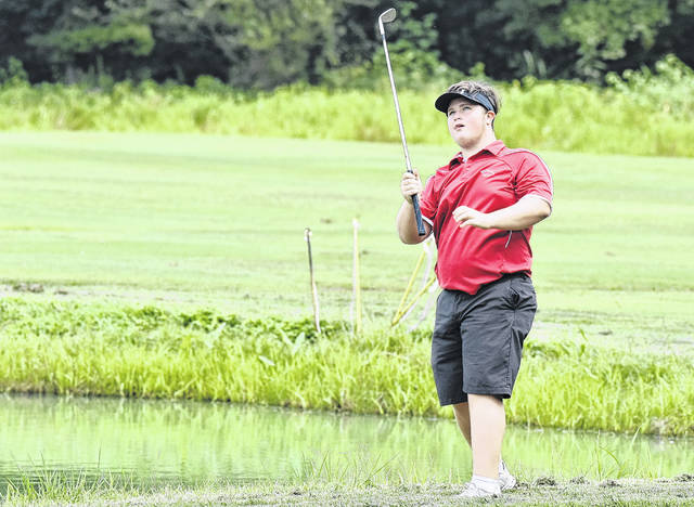 Wahama freshman Ethan Mitchell admires his shot during the White Falcons' season-opening match on Thursday at Riverside Golf Course in Mason, W.Va.