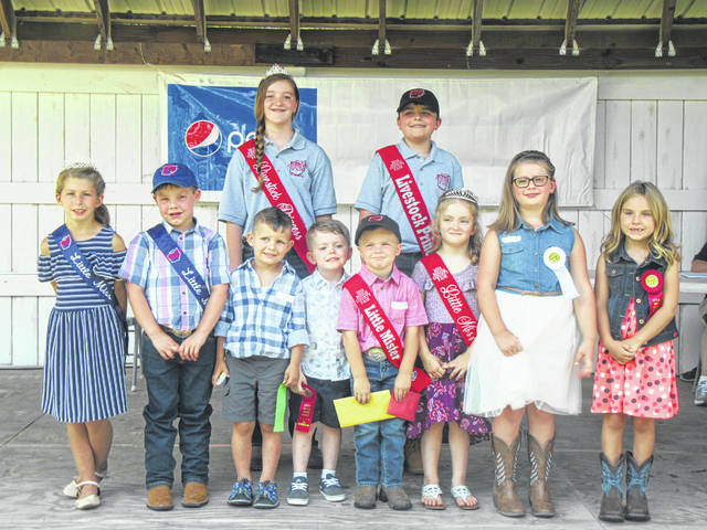 The 2018 Little Miss and Mister winners are pictured with the 2017 Little Miss and Mister and 2018 fair livestock royalty. Pictured (front, from left) are 2017 Little Miss Kayleigh Kranyick, 2017 Little Mister Cade Newland, Little Mister Second Runner-Up Axel Shuler, Little Mister First Runner-Up Kash Gheen, Little Mister Reece Davis, Little Miss Morgan Durst, Little Miss Second Runner-Up Brielle Wyatt, Little Miss First Runner-Up Paige Smith; (back, from left) Livestock Princess Raeann Schagel and Livestock Prince Matthew Jackson.