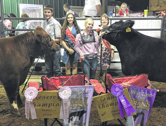 Trenton Morrissey (left) won Reserve Champion Market Steer and Jess Parker (right) won Grand Champion Market Steer. Also pictured are fair royalty Queen Mattison Finlaw and First Runner-Up Raeven Reedy.