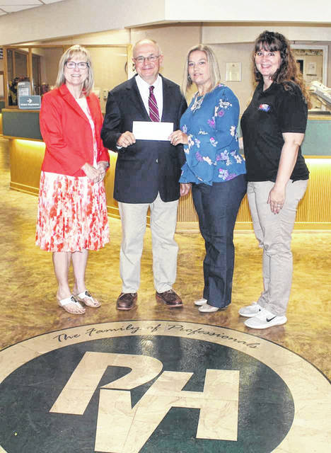 Lynne Fruth, president of Fruth Pharmacy, Glen Washington, CEO of PVH, Amy Nelson, Fruth Pharmacy category manager, and Julye Knox, manager at Fruth Pharmacy in Point Pleasant.