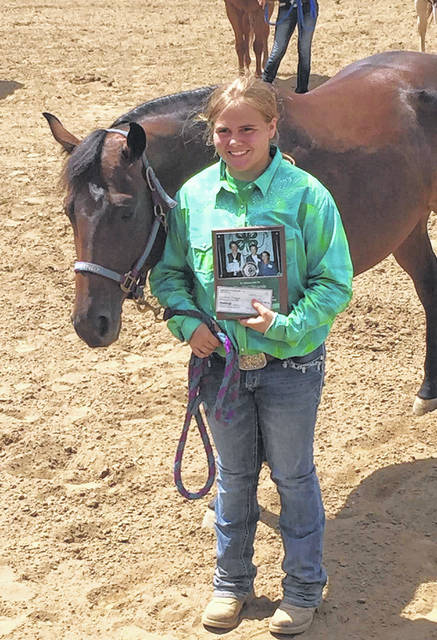 Darbi Mugrage received the Rachael Downie Award during Monday's Junior Fair Horse Show.