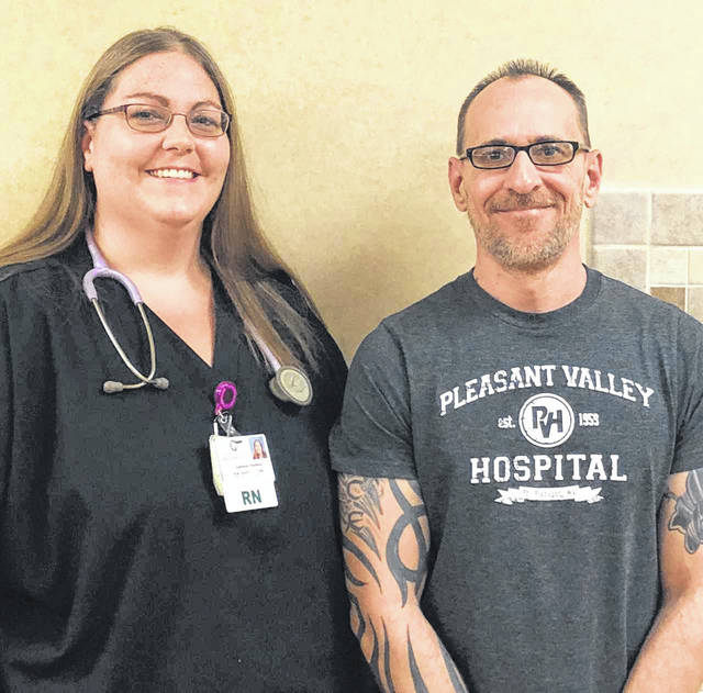 Pleasant Valley Hospital Employee of the Month Chris Gardner is pictured with Charge Nurse Cassie Haines, RN.