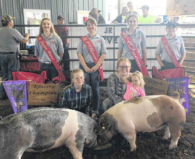 Jaycie Jordan (left) won Reserve Champion Market Hog and showman. Jenna Jordan (right) won Grand Champion Market Hog and showman. Also pictured are Livestock Princess Raeann Schagel, First Runner-Up Raeven Reedy, Queen Mattison Finlaw, Livestock Prince Matthew Jackson and the youngest Jordan sibling, Janie.