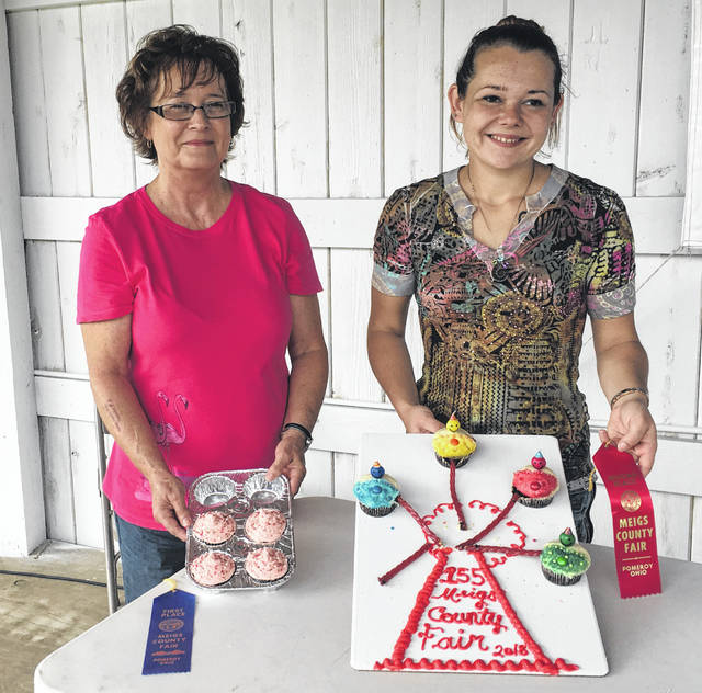 Mary Ann Shoults (left) won first place and Sara Lunsford (right) won second place in the Ladies Day Baking Cupcake Contest.