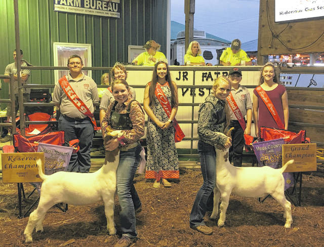 Jennifer Parker (left) won Reserve Champion Market Goat. Jessica Parker (right) won Grand Champion Market Goat. Also pictured are the 2018 Meigs County Fair Royalty King Austin Rose, First Runner-Up Raeven Reedy, Queen Mattison Finlaw, Livestock Prince Matthew Jackson and Livestock Princess Raeann Schagel.