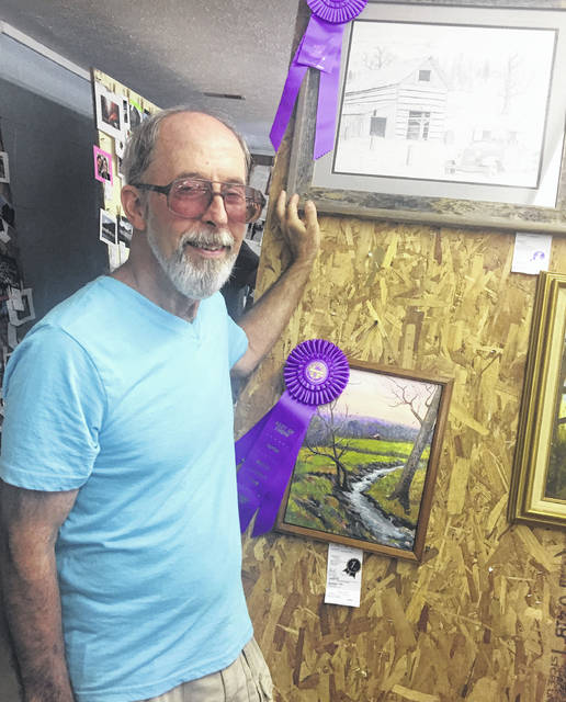 Danny Carter from Vinton, Ohio, is a regular at the Meigs County Fair with his detailed pencil drawings inspired by his wife's photography.