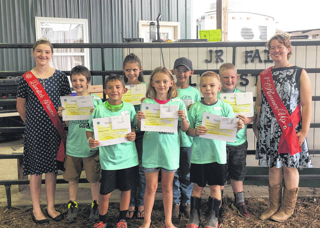 Graduates included (front row) Brenen Rowe, Peyton Richmond, Hunter Parry, (back row) Leland Parker, MacKenzie Smith, Maveryk Lisle, Cullen Patterson. Also pictured are 2018 Livestock Princess Raeann Schagel and 2018 First Runner-Up Raeven Reedy.