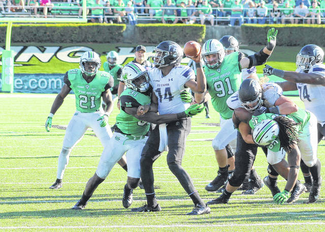 Marshall linebacker Omari Cobb (31) hits Old Dominion quarterback Steven Williams (14) during a game on Oct. 17, 2017, at Joan C. Edwards Stadium in Huntington, W.Va.