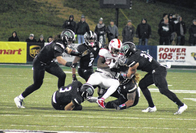 Five members of the Bobcat defense swarm a Miami ball carrier, during Ohio's 45-28 victory on Oct. 31, 2017 in Athens, Ohio.