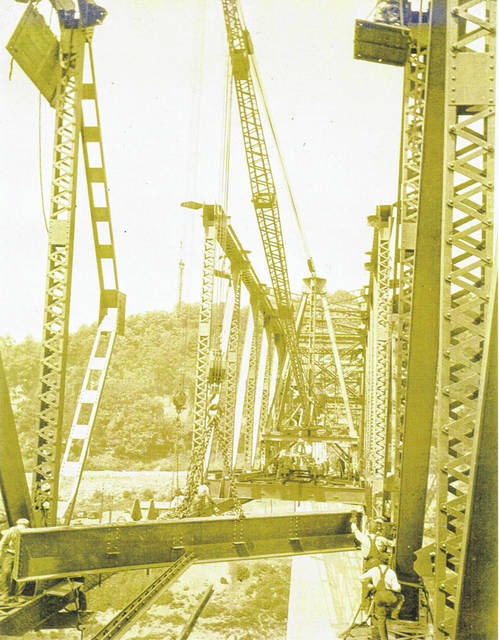 "This photo from the 1920s shows the construction work on The Pomeroy-Mason Bridge which opened to traffic in 1928. According to a 1946 newspaper article by Grace Drake, The Pomeroy Mason Bridge traces its roots back to 1914 when W.A. Compton and W.F. Reed, Pomeroy businessmen, took the leadership in promoting the project. The bridge was dedicated on Nov. 12, 1928 and closed to traffic on Dec. 30, 2008. Construction took around one year to complete. It had a cantilever span of 1,185 feet, a channel span of 665 feet and an over-all length of 2,000 feet which was nearly a half mile. Four concrete piers, with two anchor spans between the shore-ward piers supported 1,847.75 feet of ""steel superstructure"" according to the 1946 article. The larger piers extend 50 to 60 feet underground below the river bed and six feet into solid rock foundations. The Pomeroy-Mason Bridge operated as a toll bridge until 1946 when it was ""freed"" during a ceremony said to have been attended by 6,000 spectators. The ""freeing"" ceremony was described as having marching bands from both sides of the Ohio River marching across the bridge as well as an air and water show. This photo from Bob Graham's collection will be on display at Farmers Bank in Pomeroy for the next week to 10 days. Those stopping by to see the photo will have the opportunity to sign-up in a drawing to receive the photo and a puzzle, which has been made of the photo, courtesy of Graham."