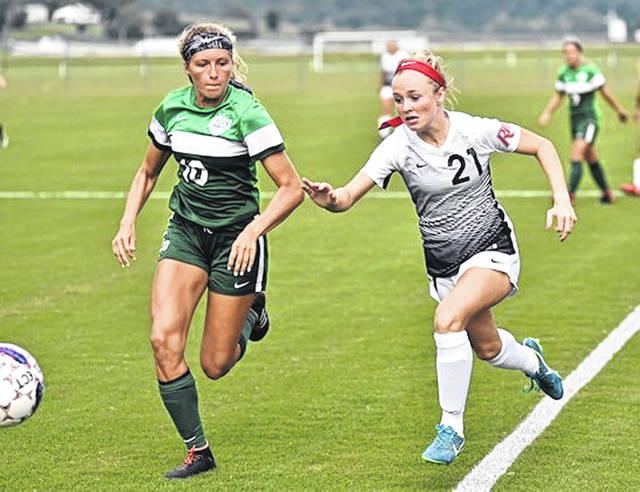 Rio Grande's Payten Davis races Mount Vernon Nazarene University's Adison Preston to the ball during the first half of Saturday night's non-conference women's soccer game at Evan E. Davis Field. The Cougars spotted the RedStorm an early lead before rallying for a 3-1 victory.