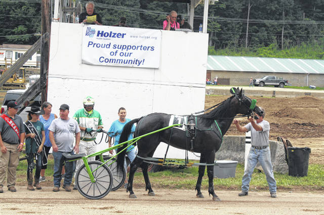Hezashiningknight pictured in the winning circle at the Meigs County Fair. The horse trained and owned by Samuel Clark of Beverly won it's first race of the year Thursday.