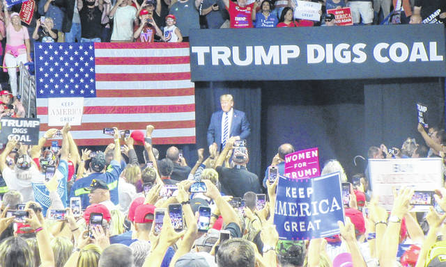President Donald J. Trump enters the Charleston Civic Center to the cheers of supporters.