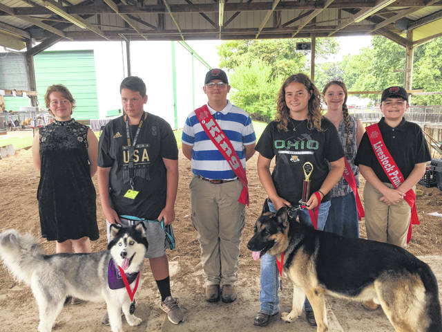 Pet show winners are pictured with Meigs County Fair Royalty. Pictured are Adam Roberts, with his Husky named Lily, who won the best dog category; Makya Milhoan, with her German Shepherd named Ruger, who won the most talented and best overall pet. Also pictures are 2018 First Runner-Up, Raeven Reedy; 2018 Fair King, Austin Rose; Livestock Princess, Raeann Schagel; and Livestock Prince, Matthew Jackson.