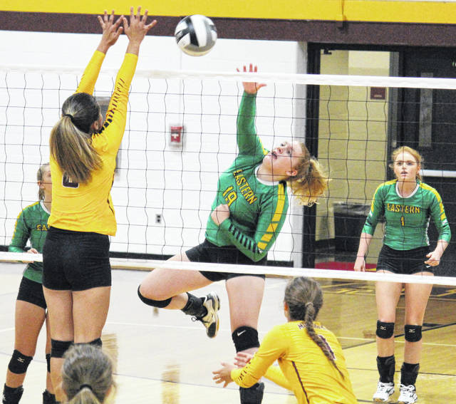 Eastern sophomore Layna Catlett (19) attempts a spike, during the Lady Eagles' victory over Meigs on Thursday in Rocksprings, Ohio.