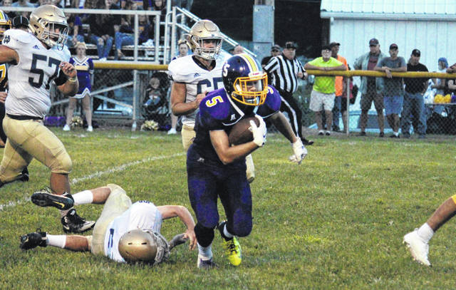 Southern junior Trey McNickle (5) breaks a 33-yard touchdown run in the second quarter of the Tornadoes' victory over Portsmouth Notre Dame on Friday in Racine, Ohio.