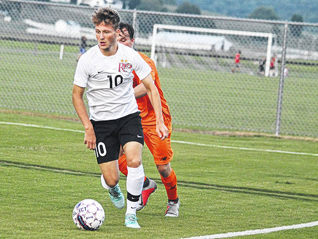 Rio Grande's Ewan McLauchlan works the ball away from an Indiana Tech defender during the first half of Saturday night's 3-0 win over the Warriors at Evan E. Davis Field.