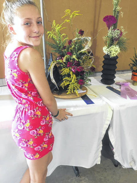 Hannah Crane is pictured with her floral display.