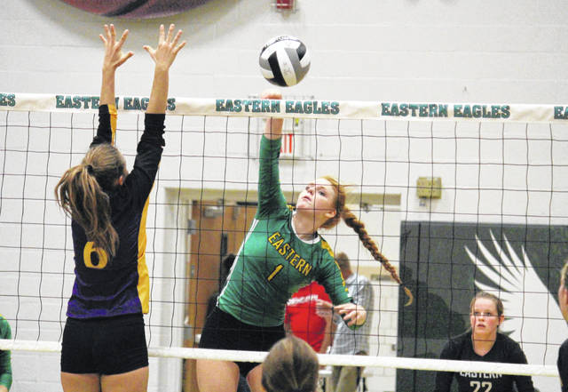 Eastern senior Allison Barber (1) spikes the ball over the net, during the Lady Eagles' straight games win over Southern on Wednesday in Tuppers Plains, Ohio.
