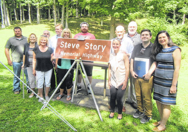 Members of the Story family are pictured with the sign which was unveiled on Friday during the dedication ceremony for the Steve Story Memorial Highway.