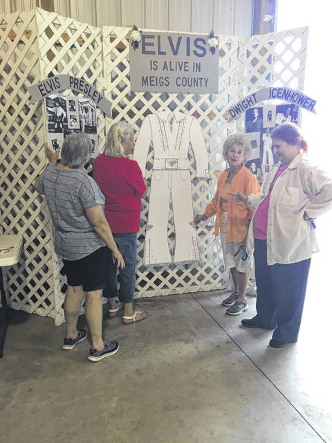 """Elvis"" was the theme of last year's show setting up from left to right: Chester Garden Club Members Sheila Curtis, Linda Blosser, along with Wildwood Garden Club members Tunie Redodian, Shirley Hamm."