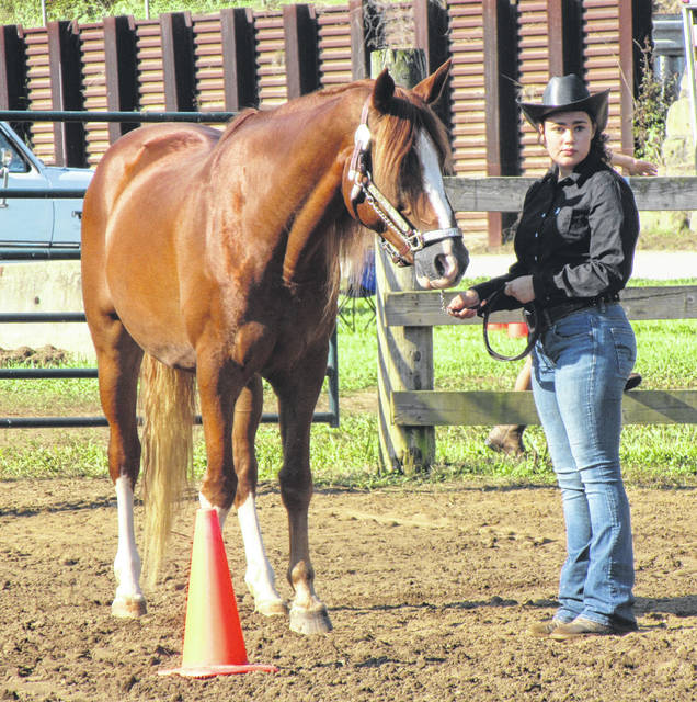 Kylee Circle shows her horse during the Junior Fair Horse Show on Monday morning.