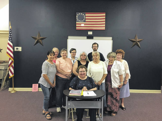 Sandy Tritt pictured in the center with guild members and guests, in front from left to right, is Mona Pickens, Wilma Acree, Carol Newberry, Sue Underwood, Ilse Burris, and in back from left to right is April Pyles, Patrecia Gray, Daniel Newberry, and Feryle Lawrence.
