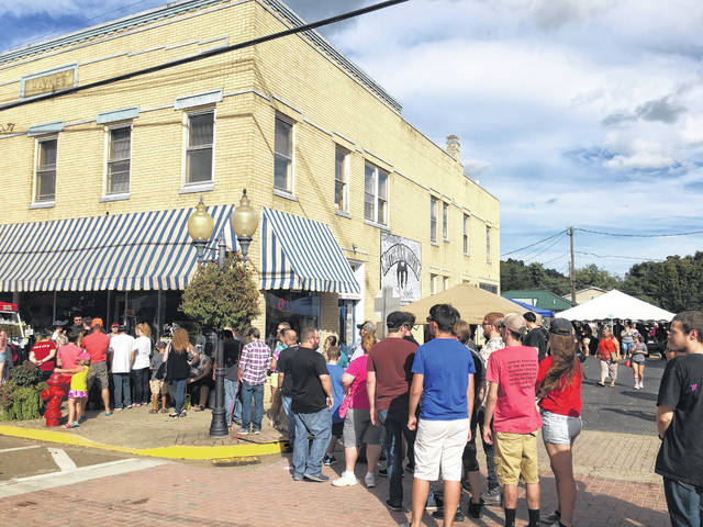 The line stayed long for festival goers wanting to visit the Mothman Museum.