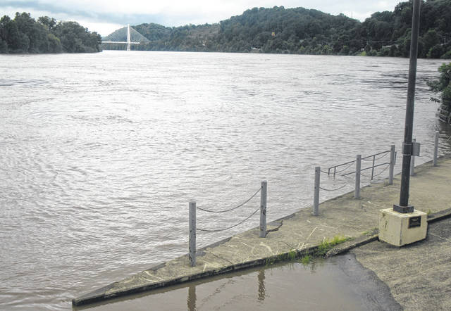 By noon on Monday the river had already begun to spill into the boat ramp on the Pomeroy Parking Lot, completely covering the amphitheater.