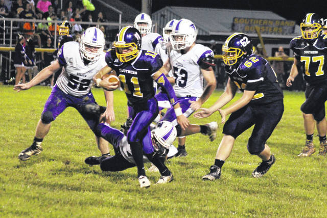 Southern senior Logan Drummer (11) breaks away from the pack, during a first half run in the Tornadoes' victory on Friday in Racine, Ohio.