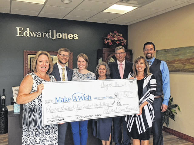 Pictured are (left to right) Jo Beth Smith with Make-A-Wish, Edward Jones FA Isaac & Jenn Mills, FA John & Kim Lewis, FA Lesley Marrero, & FA Steven Deshuk.