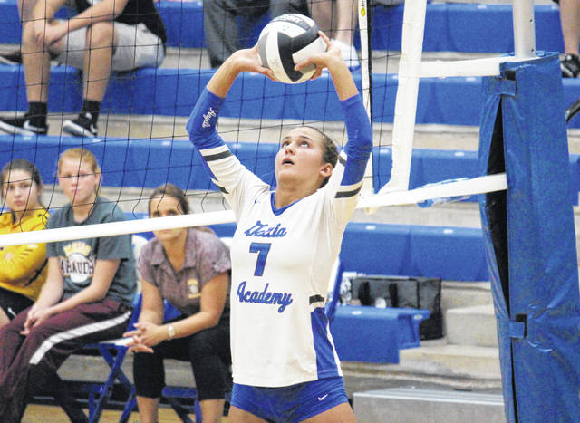 Gallia Academy junior Peri Martin (7) sets the ball, during the third game of the Blue Angels' straight games victory on Tuesday in Centenary, Ohio.
