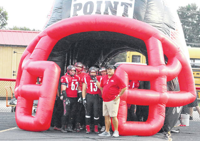 Point Pleasant head football coach David Darst stands with his team before they take the field during a Week 3 football contest against Warren at Ohio Valley Bank Track and Field in Point Pleasant, W.Va.
