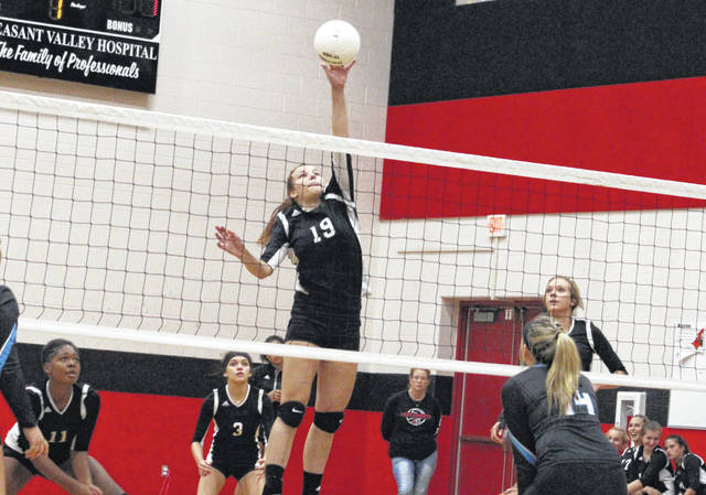 Point Pleasant sophomore Tristan Wilson (19) hits a spike attempt during Game 3 of Thursday night's volleyball match against Lincoln County in Point Pleasant, W.Va.