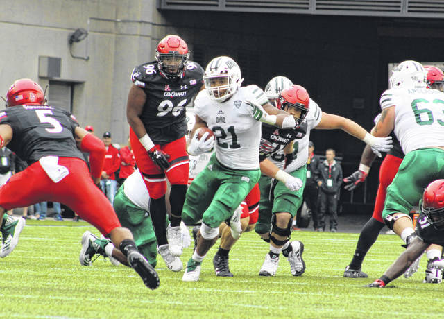 Ohio running back Maleek Irons (21) breaks through the line of scrimmage during the first half of Saturday's non-conference football game against Cincinnati at Nippert Stadium in Cincinnati, Ohio.